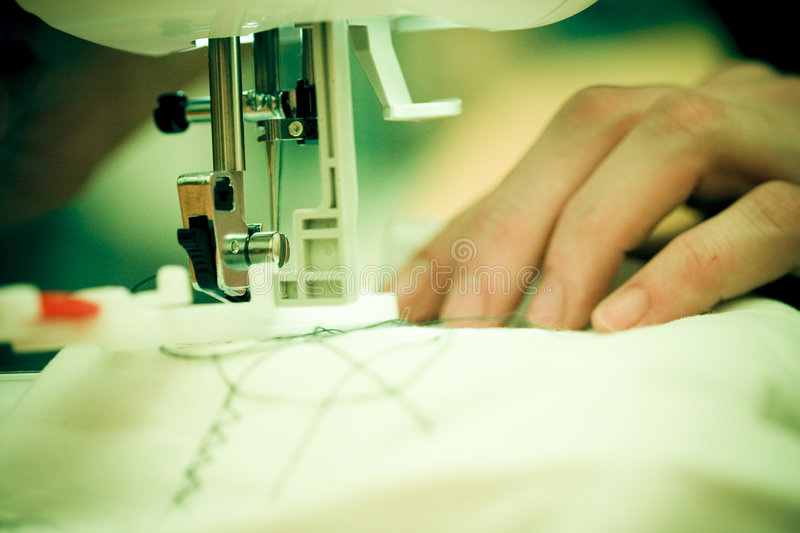 Sewing Machine. Series, woman hands royalty free stock images