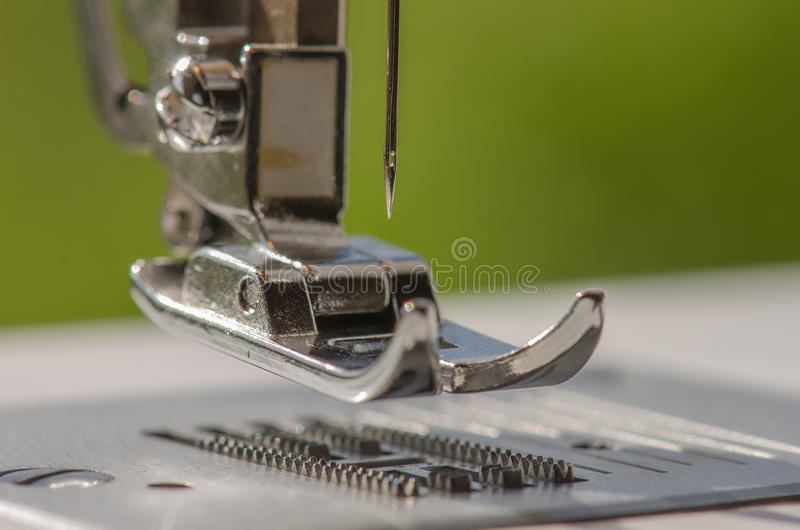 Sewing machine. Against green background stock photo