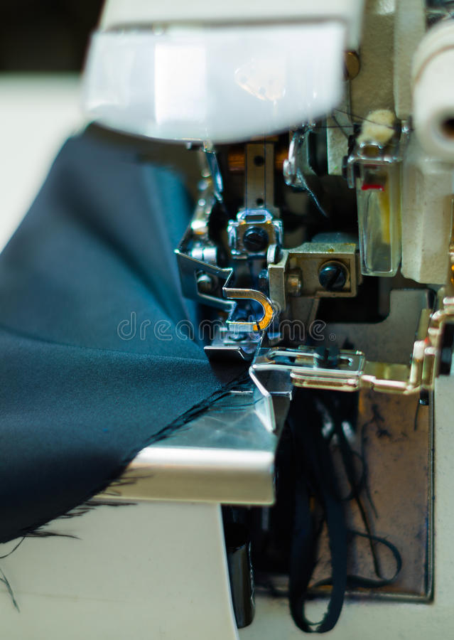 Sewing machine close up, needle making the stitches and fabric press on the front royalty free stock image