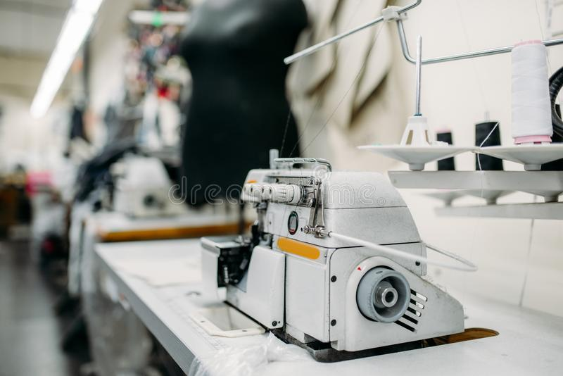 Sewing machine on clothing factory, nobody stock image
