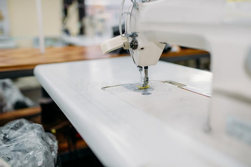 Sewing machine on clothing factory, nobody royalty free stock photo