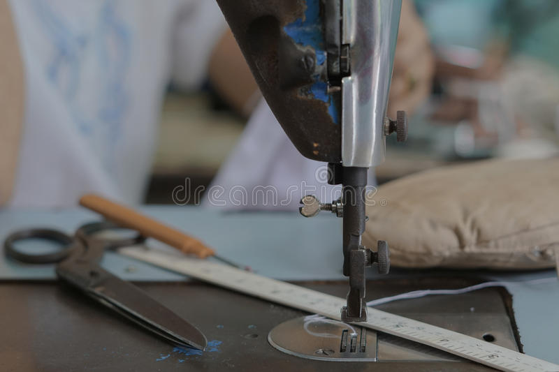 Sewing machine and local tailor. This `s shot take in Thailand. Sewing machine and local tailor. This `s shot take in Thailand royalty free stock images