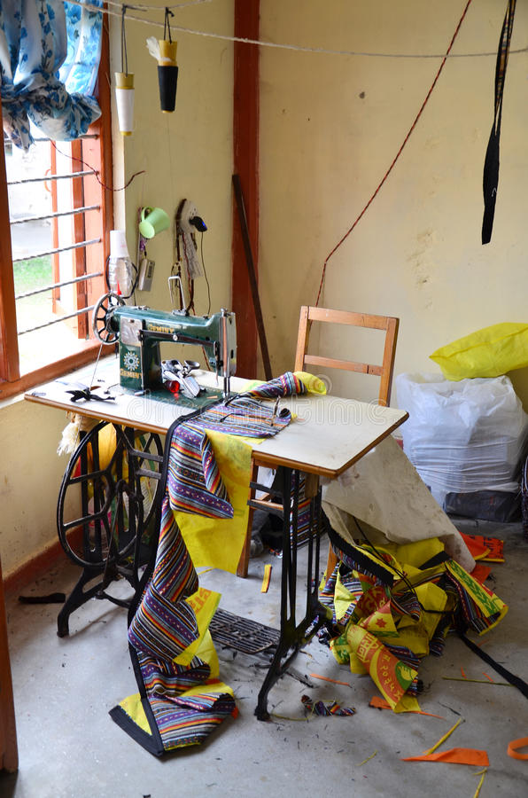 Sewing machine for make souvenir from cloth at tibetan refugee camp. Ancient Sewing machine for make souvenir from cloth at tibetan refugee camp in pokhara in stock photos