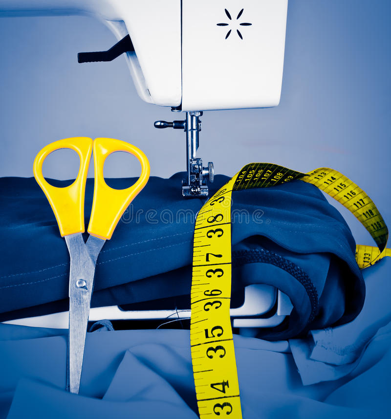 Free Sewing Machine, Measuring Tape And Scissors Royalty Free Stock Images - 24575649