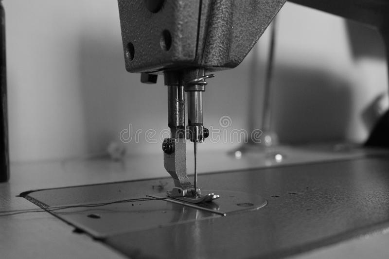Sewing machine. Black and white sewing machine stock images