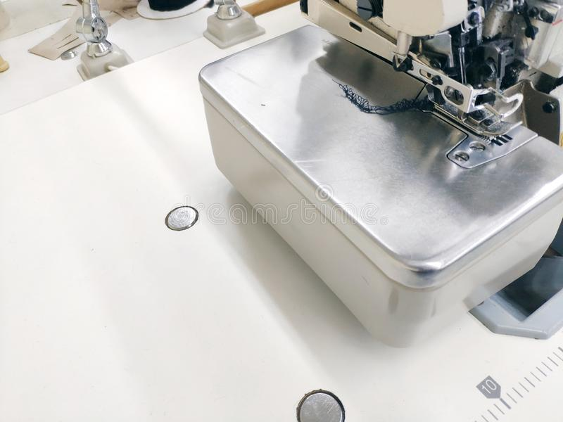 Sewing machine ready for work on a white tabletop background royalty free stock photography
