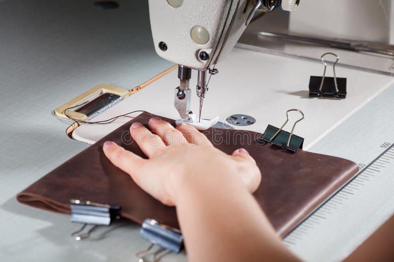 Sewing machine with womans hands royalty free stock photo