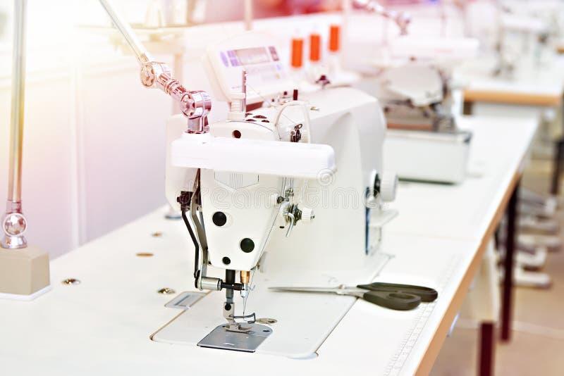 Sewing machine in workshop. Sewing machine in craft workshop stock image