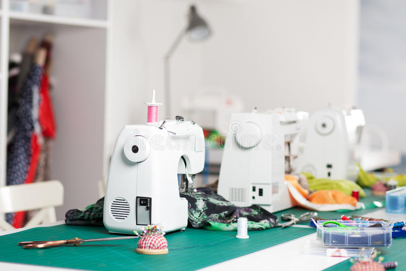 Sewing machines in a workshop. Several sewing machines in a workshop royalty free stock photos
