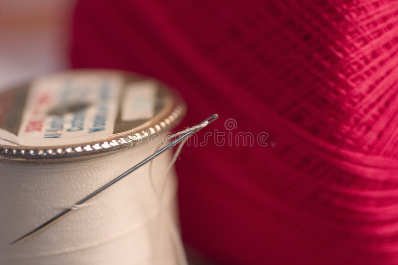 Sewing Needle. Old idea. Sewing needle and thread royalty free stock photography
