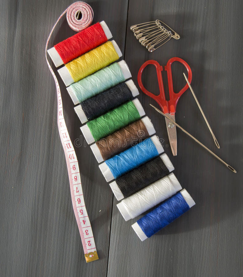 Sewing needle and colored spool yarns, multicolored spool yarns, sewing and sewing needles, scissors and scissors, tailoring mater royalty free stock image