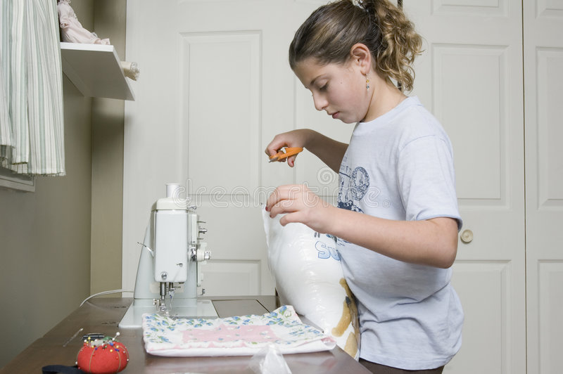 Download Sewing A Pillow 1 Royalty Free Stock Image - Image: 1720486