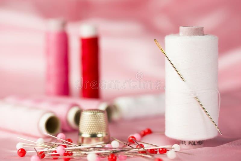 Sewing pink stock image