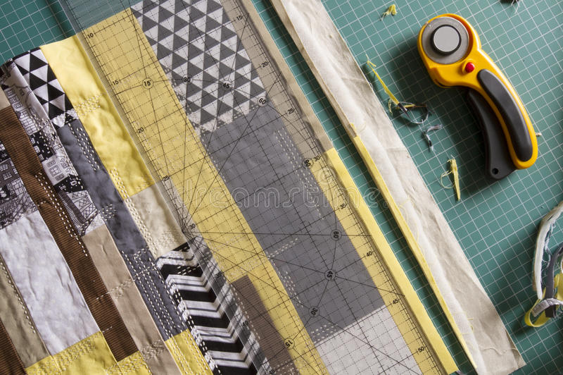 Sewing process in fabric cutting stage. Textile straps are cut of stock photography