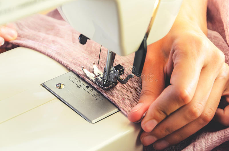 Sewing process on the sewing machine royalty free stock image