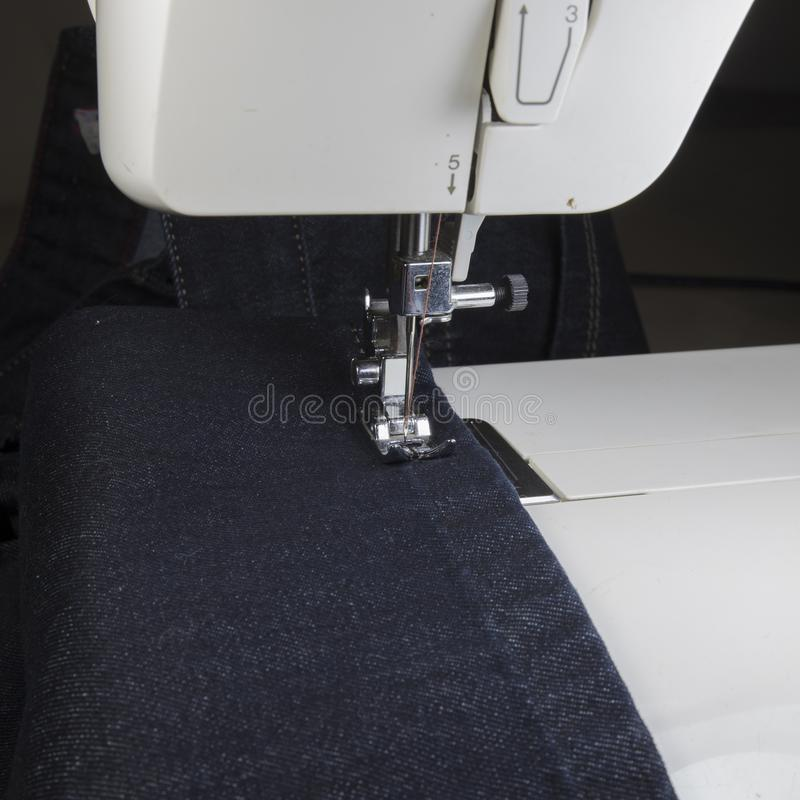 Sewing process on the sewing machine stock image