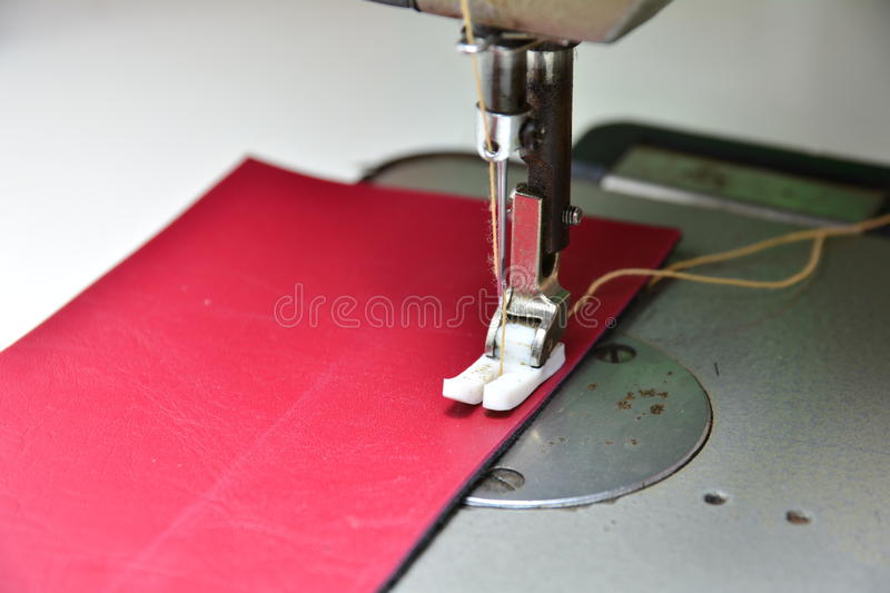 Sewing process in the phase of stitching. Sewing process in the phase of over stitching stock images
