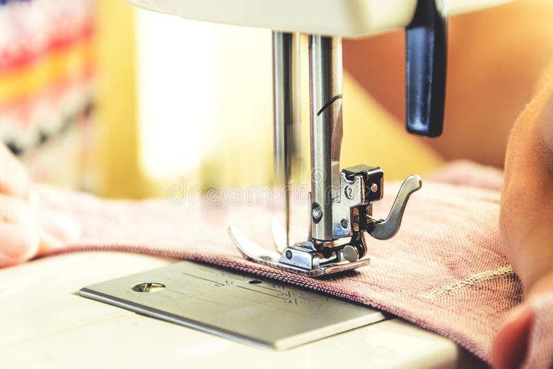 Sewing process on the sewing machine stock photography