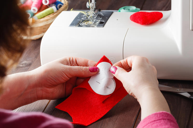 Sewing Process - Women's hands behind her sewing, toy made royalty free stock photography