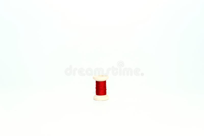 Sewing set: fabrics and threads on wooden table stock photo