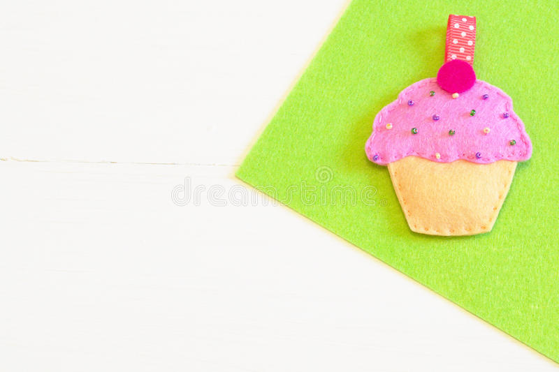 Sewing set for felt cupcake. Baby keychain - felt cupcake. Sewing craft idea. Sewing needlework concept. Sewing needlework tutorial. Sewing crafts master class royalty free stock photo