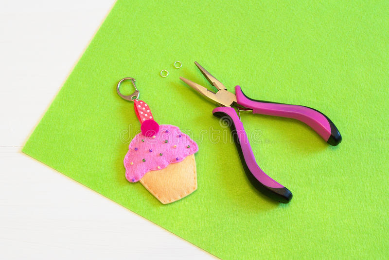 Sewing set for felt cupcake. Baby keychain - felt cupcake. Sewing craft idea. Sewing needlework concept. Sewing needlework tutorial. Sewing crafts master class stock photos