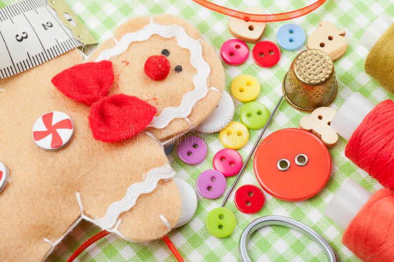 Sewing set and handmade gingerbread man from textile stock photography