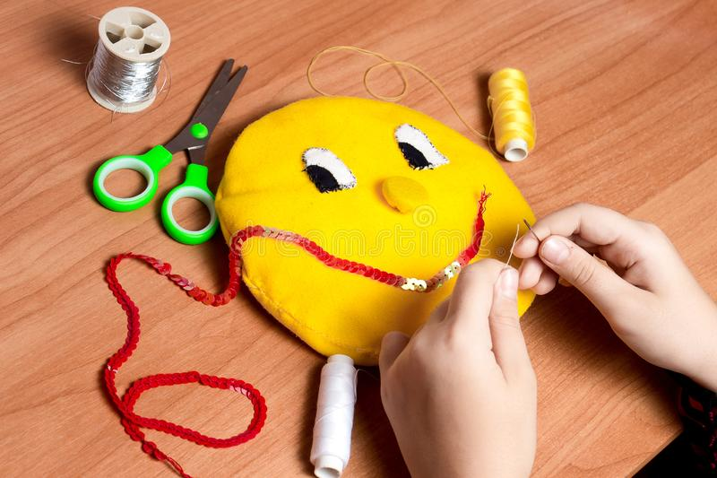 The child lives in a soft toy in the form of a yellow sun royalty free stock photography