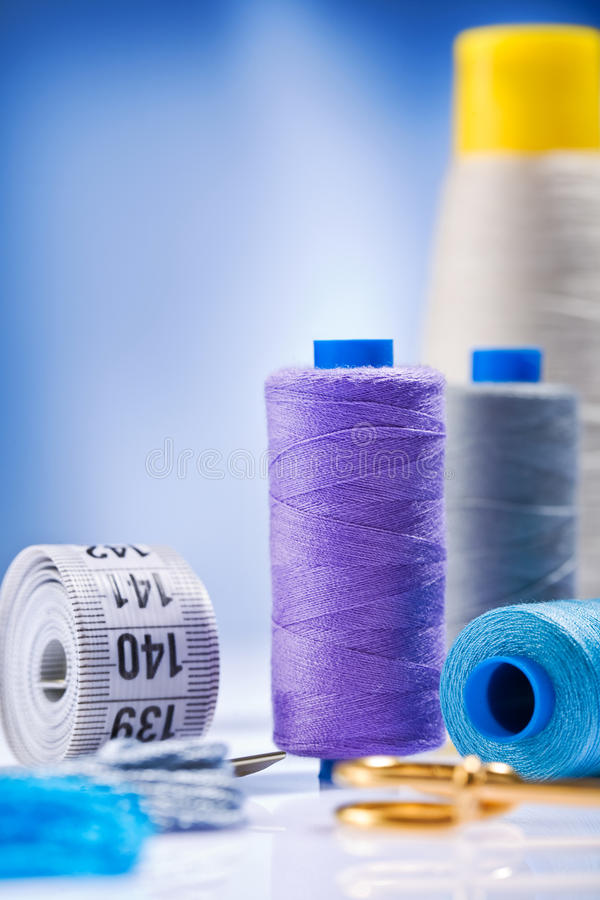 Sewing spools with threads and other items. Studio shot composition of sewing spools with threads and other items on white table stock photography