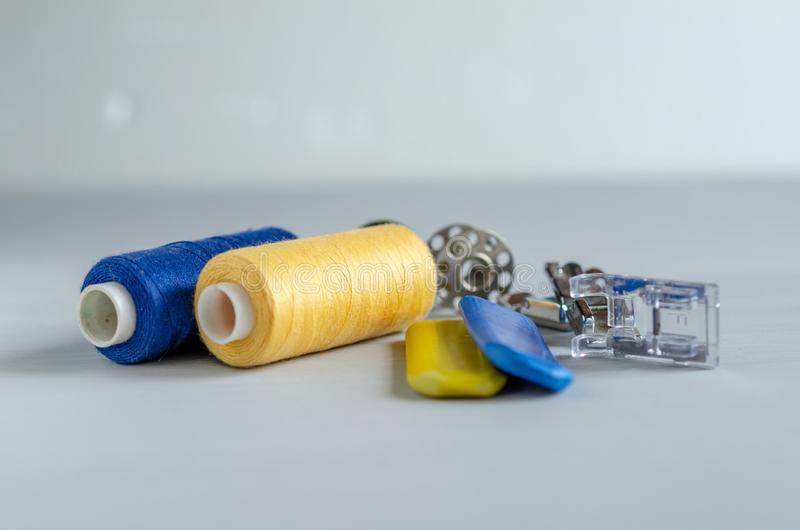 Sewing supplies and needlework accessories blue and yellow colors. Tailoring and craft concept.  stock images