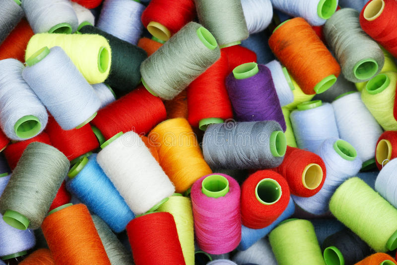 Sewing thread. The background of sewing thread stock image