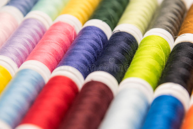 Sewing thread. Bobbins with sewing thread in many different colors stock image
