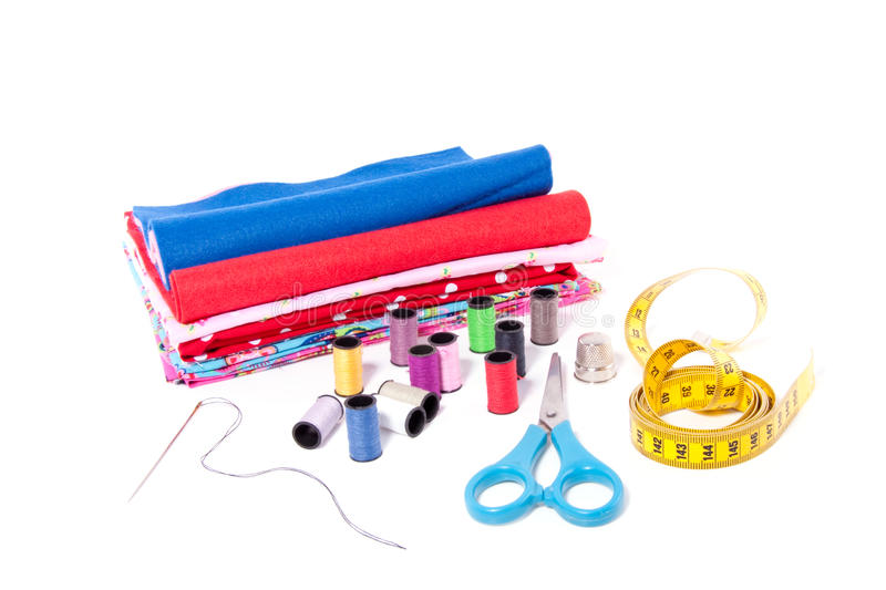 Sewing thread and fabrics royalty free stock photo
