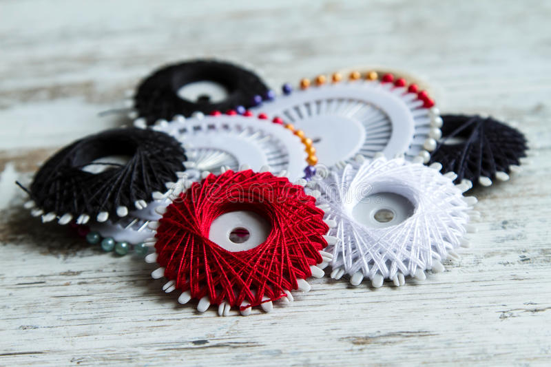 Sewing thread. Group of sewing thread and stickpins royalty free stock image