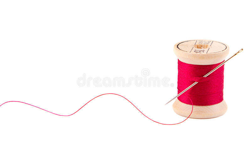 Sewing thread and needle royalty free stock photos