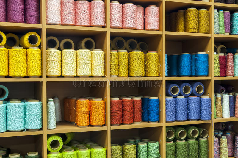 Sewing threads in a stock. Colorfull sewing threads in a stock royalty free stock image