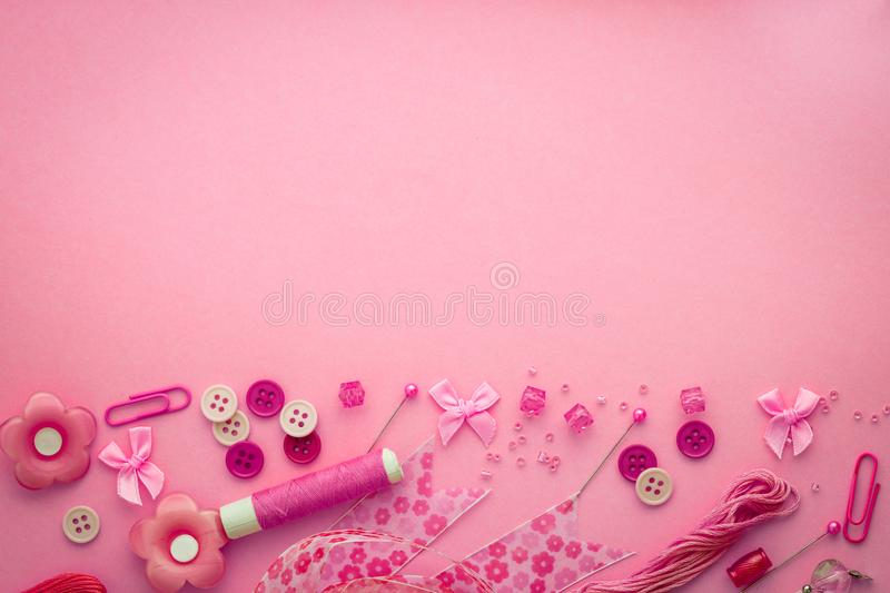 Sewing tool or craft tool on a pink background , top view or ov royalty free stock photos