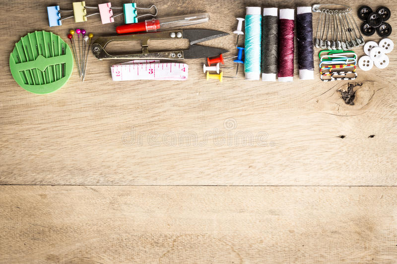 Sewing tools equipment space on wood. Sewing tools equipment space for sample text wood background royalty free stock photo