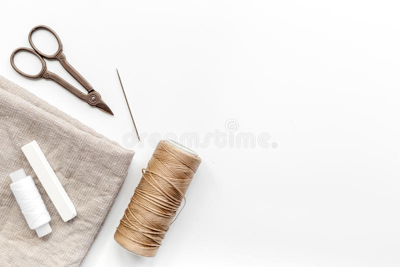 Sewing tools, fabric and kit for hobby collection on white background top view mock-up royalty free stock photos