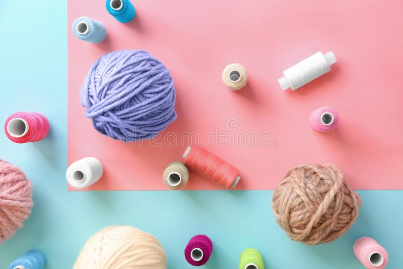 Sewing and woolen threads on color background,. Top view royalty free stock photos