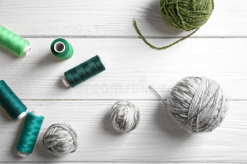 Sewing and woolen threads. On wooden background, top view royalty free stock image