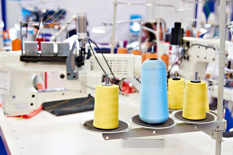 Sewing workshop with threads. And electric sewing machines stock photos