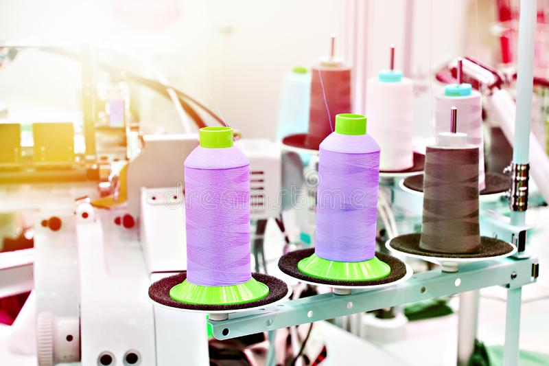 Sewing workshop with threads. And electric sewing machines royalty free stock images