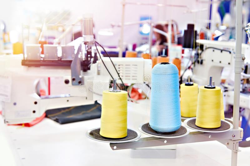 Sewing workshop with threads. And electric sewing machines royalty free stock photo