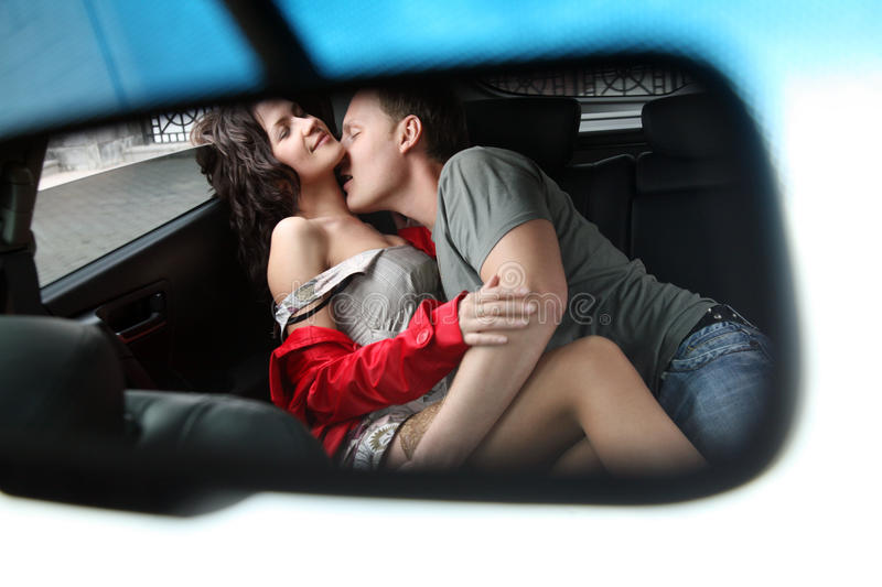 Man and woman having sex in a car