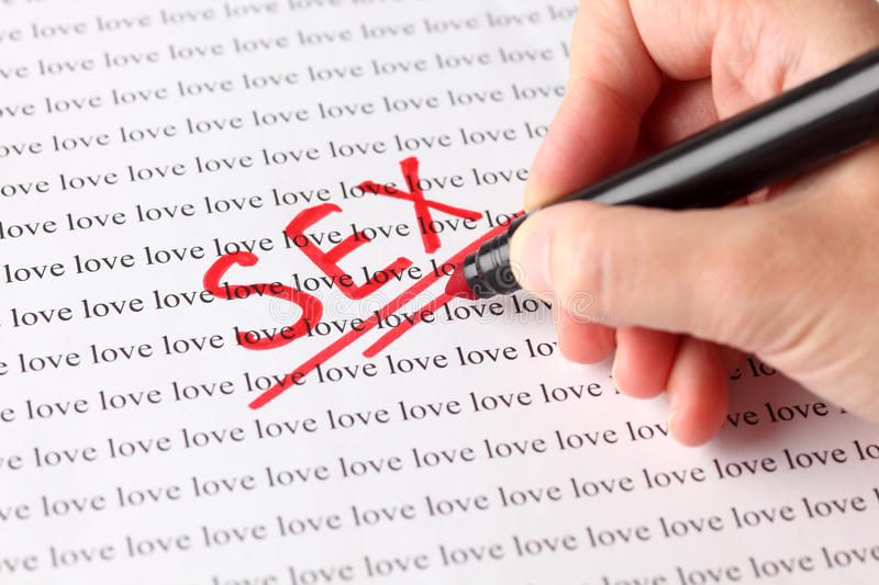 Sex and love. Woman's hand with red pen writing word Sex on the background of words Love stock photography