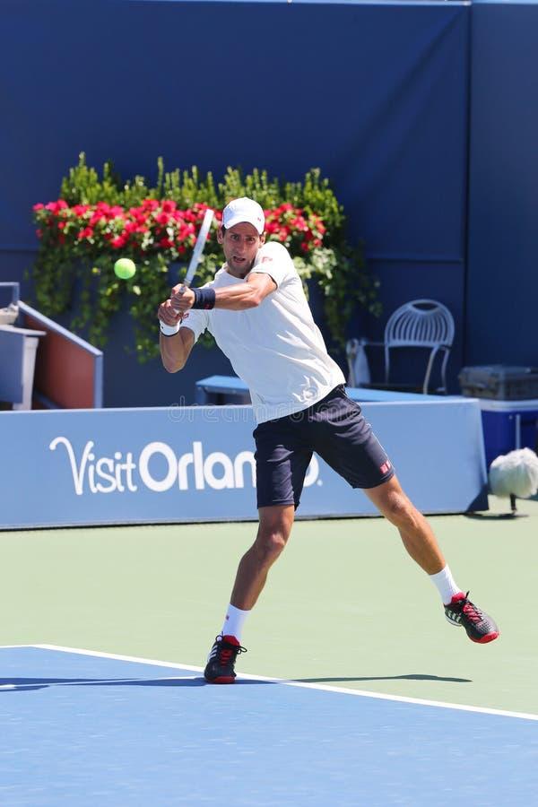 Sex mästare Novak Djokovic för storslagen Slam för tider öva för US Open 2014 royaltyfri foto