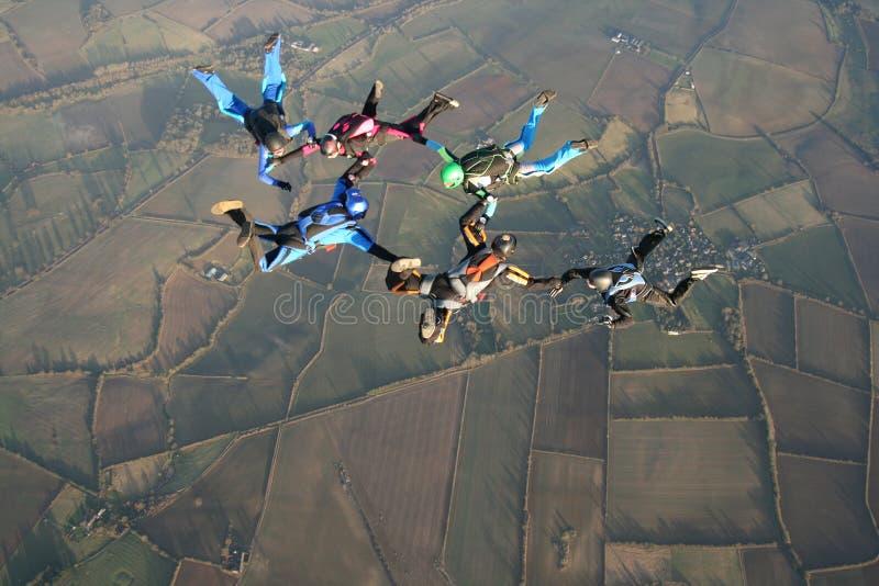 sex skydivers arkivfoto