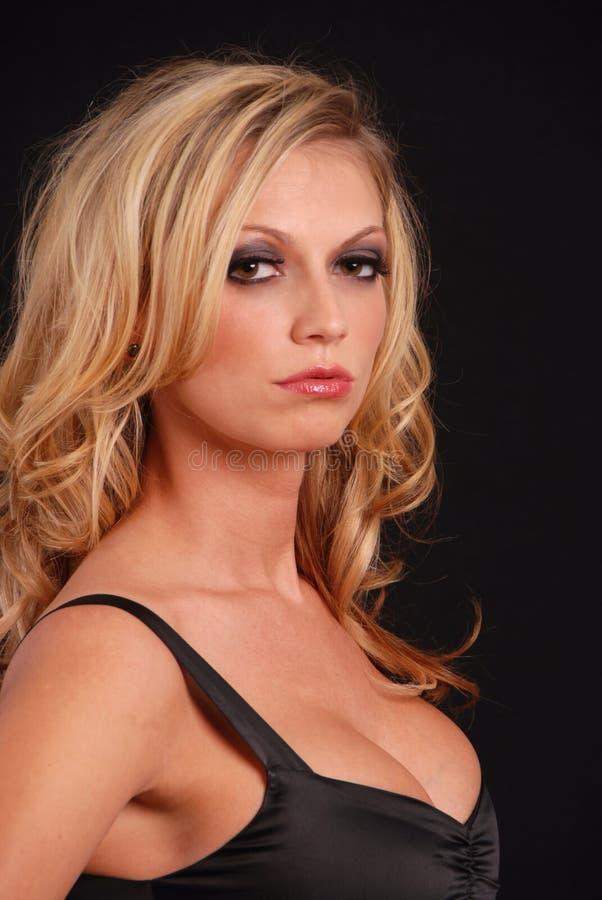 sexig överkant för svart blond kvinnlig arkivbild