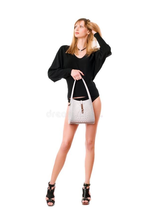 Sexig dam med den vita handväskan royaltyfria bilder